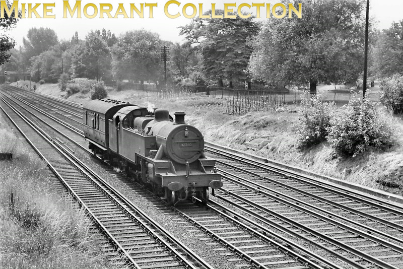 We were used to seeing Fairburn and Standard 4MT 2-6-4T's on the Brighton main line in south London but a Fowler example was something of a rarity. This is ex-LMSR Fowler 2-6-4T no. 42350 accompanied by an LMSR parcels van on the Up Slow line between Wandsworth Common and Clapham Junction stations. Although not dated no. 42350 was allocated to Willesden mpd from 9/59 until 5/63 and so this shot was taken between those dates.