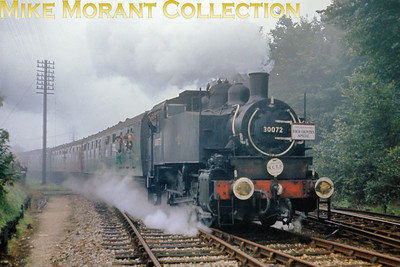 SCTS: The Four Counties Special 9/10/66 USA tank No. 30072 makes a spirited departure from Merton Park station en route for Wimbledon having just visited the Tooting Goods branch on this cold and misty morning.
