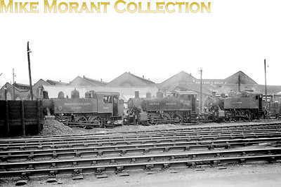 Although not of the best quality this shot is of too great an interest to languish. This is Southampton docks in 1948 and depicted is a line-up of three USATC S100 class 0-6-0 tank engines in different liveries. On the left is USATC liveried no. 4326 which entered SR service in June 1947 would be BR branded as 30074 in either July or November 1948 depnding on which source should be believed. In the middle is BR liveried no. 30067 which had been BR branded in April 1948 whilst the Southern liveried loco could be either 62, 63 or 65 but the critical digit is indecipherable. [Mike Morant collection]