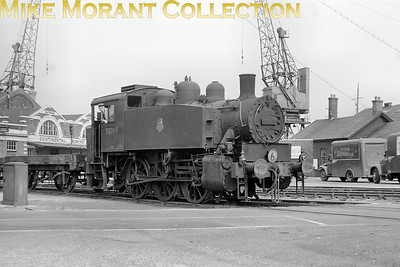 Ex-Southern Railway USA tank no. 30069 at Southampton docks on 2/7/53 but perhaps the greater interests in this image are the nicely positioned loading cranes, the Continental Booking Office building's facade and the delightful Stork Margarine delivery van on the right.