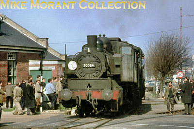 RCTS: The Solent Rail Tour 20/3/66. Green liveried USA 0-6-0T no. 30064 arrives at Southampton (Ocean Terminal).