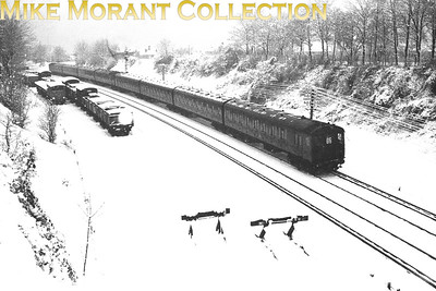The Big Freeze of 1963 actually started in the south of England with heavy snowfalls on the 26th and 27th of December 1962. This shot was taken from King's Lane overbridge in Sutton before the end of 1962 and depicts a pair of 4-Epb electric units with a Holborn to West Croydon service, headcode 06, having just left Sutton, next stop Carshalton Beeches. [Mike Morant]
