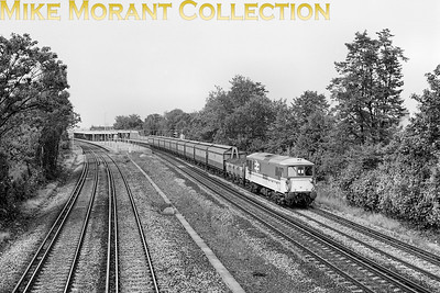 An unidentified class 73 ED Bo-Bo electric locomotive in charge of a train comprising continental vans passes southwards on the Down slow line through Norbury, London SW16. My entire interest in railways originated from this same vantage point well over 70 years ago although it is some 25+ years since I was last there. [Mike Morant collection]