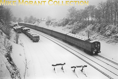 The Big Freeze of 1963 actually started in the south of England with heavy snowfalls on the 26th and 27th of December 1962. This shot was taken from King's Lane overbridge in Sutton before the end of 1962 and depicts a pair of 4-Sub electric units with an Epsom Downs to Victoria service, headcode 84, having just left Sutton, next stop Carshalton Beeches. [Mike Morant]