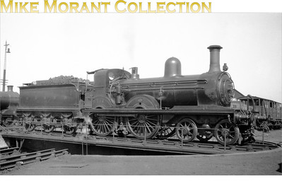 In G&SWR (Glasgow & South Western Railway livery, Smellie designed 4-4-0 No. 712 photographed in 1921 on a turntable at an unspecified location. The loco isn't in its original condition as m by this time, it had acquired an X3 boiler and Whitelegg cab. The 119 class were known as 'Wee Bogies' by the engineman but that didn't help to prolong their working lives as the LMSR disposed of all GSWR motive power with something approaching indecent haste this example being withdrawn in 1930 following a 47 year working life.
