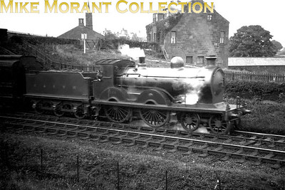 This steamy but not quite crisp shot features Manson 18 class 4-4-0 no. 346 departing from Annan and the Glasgow & South Western Railway livery is still in evidence even though this undated view was probably taken just after the 1923 grouping. Note the flat sided 2900 gallon tender which was unique to this class of 4-4-0's.
