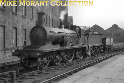 """Glasgow & South Western Railway 4-4-0 no. 462 was a Hugh Smellie designed 153 class built at the railways's own Kilmarnock works in the 1889. No. 462 became no. 14154 in the LMSR fleet list and survived only until March 1927. This image has no supplied data but a viewer has kindly sent me the following: """"This is the north side of Kilmarnock station, looking approx. north east.  Beyond the tender and wagon is the western end of the twin-gabled building whose eastern end appears in two previously identified shots.  On the left is the Elmslie Woollen Mills whose western end, to the left of the camera in this shot, appears on right of the picture of 14242."""""""