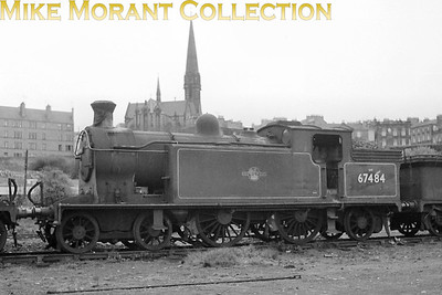 NBR Reid designed C16 class 4-4-2T no. 67484 is depicted here in store at the former Caledonian shed at Dundee probably shortly after withdrawal in April 1960. The last rites were performed at Inverurie works during the following month. [Mke Morant collection]