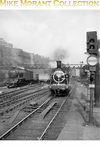 Former NBR Holmes designed J83 class 0-6-0T no. 68474 is shown here on station pilot duty at Edinburgh Waverley station in June 1957. Photo taken by Mike Morant