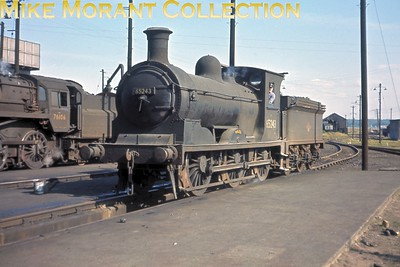 Former NBR Holmes era J36 class 0-6-0 no. 65243 Maude at Bathgate shed on August 31st 1964. Maude survived into the heritage era and is currently (October 2014) awaiting its next major refurbishment in the capable hands of the Bo'ness and Kinneil Railway. This Ektachrome-X slide was one of two featuring this engine that I took myself. The other one, a side-on shot, has been one of the most viewed images on both this web site and my erstwhile Fotopic one as well as having been published in print at least twice. Foir some reason this shot has always lurked in the background but, IMHO, it's arguably the better of the two. [Slide taken by Mke Morant]