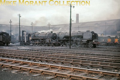 Glasgow's Polmadie shed in August 1963 with a Standard 5MT 4-6-0, a Stanier pacific and a pair of Clayton's in shot. [Mike Morant]