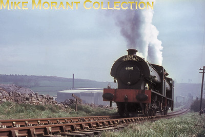 """SLS: Farewell to the Former L.N.W.R.'s Cromford & High Peak Railway 30/4/67 J94 0-6-0ST's 68012 & 68006 on 30/4/67. This shot was taken near the bottom of  the Hopton incline on the Cromford and High Peak. Peter Kellett has kindly sent me the text and images from the June 1967 SLS Journal. The text starts with the following sentence:""""The last day of official operations on the Cromford and High Peak line, Sunday,30th April 1967, was marked by scenes that beggar description ......""""The rest of the two pages devoted to that day's events are revealing as there is a picture of 68012 and 68006 with the SLS headboard clearly visible and the text states that the first run of the day, there were three in total, was chartered by the SLS (Midland Area).The puzzle regarding 68012 wearing a 50A (York) shed plate on its smokebox door is partly answered by Peter with this quote from the June 1967 Railway Observer: """"68012 commenced the operations sporting a 50A shed plate, but this had been removed by the afternoon."""". So, now we've narrowed down the time frame for this shot to the morning of 30/4/67 but why the 50A plate in the first place?"""