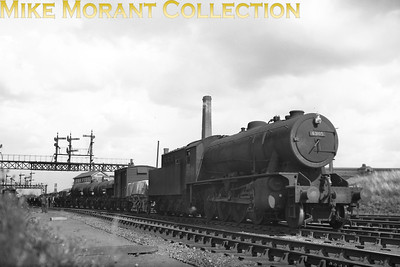 An unusual shot insofar as the featured WD 2-8-0 is one that carried a BR 63xxx number. No. 63105 had, of course, previously been LNER 3105 under that railway's 1946 renumbering scheme. Prior to that 3105 had been WD No. 77110 and was loaned to the LNER, first allocation was Springhead, in March 1946 with outright purchasing following in December of that same year. Transfer to Heaton came in April 1947 and then to Newport in April 1949. It was during the period at Heaton that 63105 was finally renumbered as BR 90426. Withdrawal came from Ardsley mpd in March 1965.