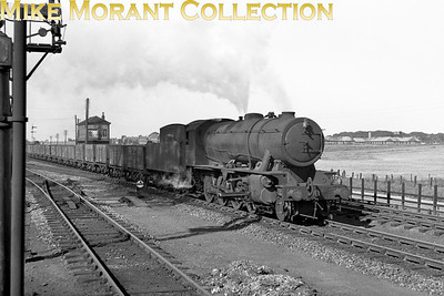 WD Austerity 2-8-0 No. 77063 was one of this class that spent its entire working life in Scotland where this shot was almost certainly taken. The BR number 90534 was applied in 10/49 whilst it was allocated to Thornton Junction mpd. Withdrawal was from Dunfermline mpd in 1966. If anyone recognises the location then please let me know.