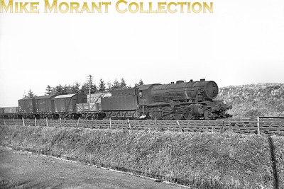 WD Austerity 2-8-0 No. 77053 on a Western Region freight circa 1948. The is loco was one that was refurbished after the war at Swindon ditinguished by the top feed cover. The allocated BR number was 90524 which was applied in 2/49. 77053 was allocated to either Canton or Pontypool Road when this shot was taken and would eventually be withdrawn from Woodford mpd in 1963. If anyone recognises the location then please let me know.