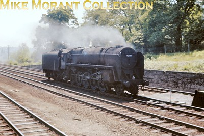 BR Standard 9F 2-10-0 no. 92188 hurries northbound as a light engine movement approaching Hadley Wood on 1/6/63. [Slide taken by Mke Morant]