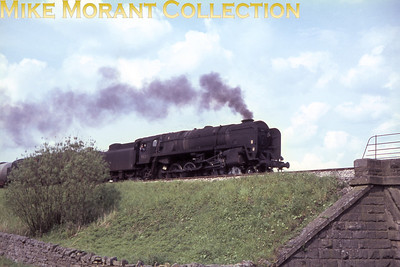 BR Standard 9F 2-10-0 no. 92212 traverses the Setlle & Carlisle line at Eldroth on May 30th, 1967. We are fortunate that this is one of the 9F's that survived into the heritage era and is in working order at the time that this was written in 2013.