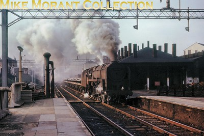 BR Standard 9F no. 92144 storms through Watford Junction station in March 1964. [Mike Morant collection]