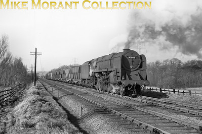 Bidston allocated BR Standard 9F 2-10-0 no. 92046 is in charge of the 3:55 Bidston - Shotton iron ore train at Storeton on 1/3/58.