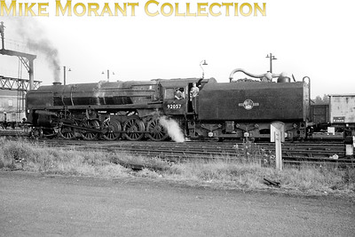 Recently outshopped BR Standard 9F 2-10-0 no. 92057 at Bromsgrove. It's an odd place to see it as its home shed throughout 1962 was Annesley but this was probably taken in the January of 1962 just after being coupled with BR1F tender no. 1157 formerly aligned with no. 92092. [Mike Morant collection]