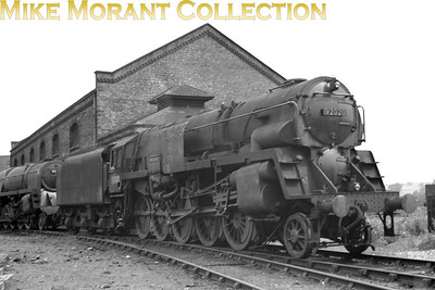 A genuine BR Standard Franco-Crosti 9F 2-10-0 no. 92020 at its home shed of Wellingborough on 29/7/56. Conversion to non-Crosti form took place at Crewe works between March and June 1961 whilst withdrawal would take place at Brikenhead mpd in October 1967.