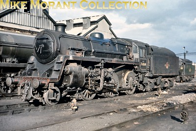 BR Standard 4MT mogul no. 76064 at Nine Elms shed. I don't have a date for this shot but I think it was taken at the very end of SR steam and 76064, despite being an Eastleigh engine when this shot was taken, would not be steamed again. [Slide taken by Mike Morant]