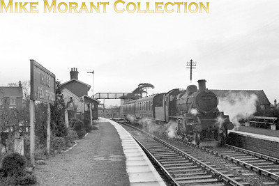 This is more about the location than the stock. An unidentifiable BR Standard 2MT 2-6-0 awaits departure from Hope & Penyffordd station on the Chester - Denbigh line probably just prior to the ex-LNWR station's closure on 30/4/62. [Mike Morant collection]
