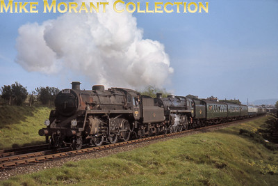 LCGB: The Dorset Coast Express 7/5/67 An impressive shot of BR Standard 4MT mogul no. 76026 and 5MT 4-6-0 no. 73029, with the latter in lined green livery, forging up Upwey bank on the climb from Weymouth to Bincombe tunnel. This would be impossible to take today as the photographer would be buried under what is probably the NE corner of Morrison's superstore but this was a favourite spot for train photographer's back in the day.