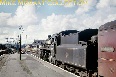 BR standard 4MT 2-6-0 no. 76007, a Salisbury engine when this shot was taken, awaits the release of the home signal at Weymouth whilst in charge of the 4.47 to Bournemouth on August 5th, 1966. 76007 would move to Bournemouth mpd in March 1967 and survive to the end of SR steam in the July. Note the youthful spotters! [Mike Morant collection]