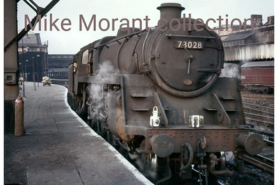 BR Standard 5MT 4-6-0 no. 73028, an 82E Bristol Barrow Road engine, far from home at Manchester Victoria  on 23/7/61