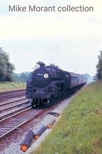 BR Standard 5MT 4-6-0 no. 73037 in charge of a Down Waterloo to Basingstoke train near Hook on 10/6/67. [Slide taken by Mke Morant]