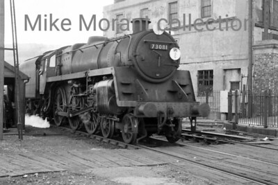 BR Standard 5MT 4-6-0 no. 73081 negotiates a road crossing in Southampton Docks. 73081 didn't last until the end of SR steam being withdrawn in July 1966 whilst allocated to Guildford shed.