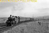 <center><b>SLS: Nottinghamshire Coalfield Rail Tour 27/4/57</b></center> BR Standard 2MT 2-6-2T No. 84006 but what is the location? There were many stops of about five minutes each during this tour but the spread of photographers suggests that this photo runpast might have been at or near Bestwood Park Junction which was  slightly longer at eight minutes.