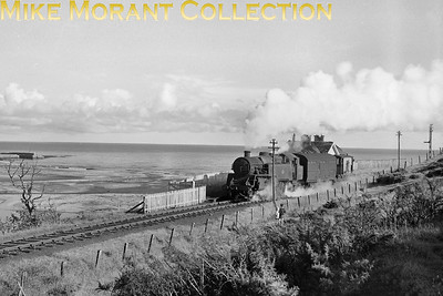 BR Standard 4MT 2-6-4T no. 80021 with six wheeled van and brake van passing the erstwhile Banff Bridge station (closed in October 1951) on the branch line from Inveramsay to Macduff. 80021, a Brighton built engine, was allocated to Kittybrewster from November 1951 until June 1961. [Mike Morant collection]