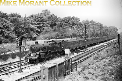 An irrestible negative for me. BR Standard 4MT 2-6-4T no. 80012 bisects Tootinmg Bec Common with a down Eastbourne via Oxted and Eridge train on 7/5/52. The rolling stock is a delight to see, two birdcage sets probably in red livery, whilst the presence of the semaphore signals came as something of a surprise. 80012 was built at Brighton, entered service at Tunbridge Wells West in August 1951 and remained on the SR for its entire working life almost lasting until the end of steam but was withdrawn at Nine Elms in March 1967.