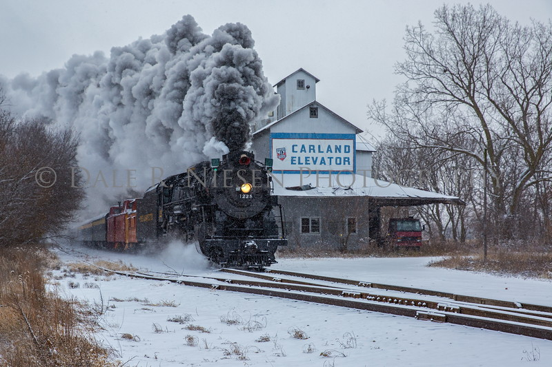 The Pere Marquette Railway Steam Locomotive No.1225 passing through Carland, Michigan during a snow shower 12/09/2017.