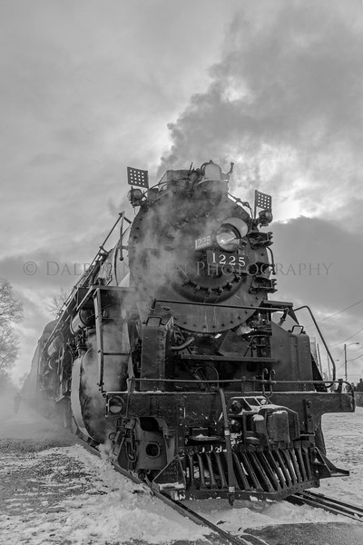 The Pere Marquette Railway Steam Locomotive No.1225 with a light flurry of snow falling. Black & white photo taken at Ashley, Michigan 12/09/2017.