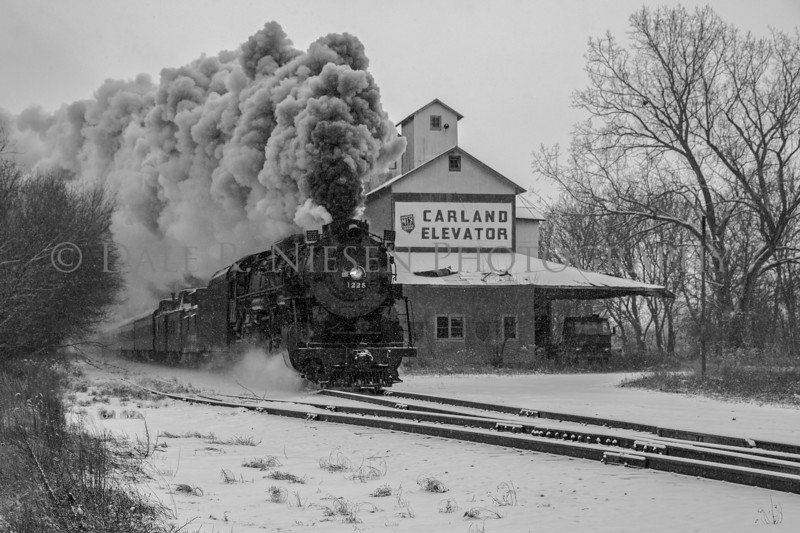 The Pere Marquette Railway Steam Locomotive No.1225 passing through Carland, Michigan during a snow shower 12/09/2017. (black & white)