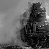 The Pere Marquette Railway Steam Locomotive No.1225 looks ominous as she is engulfed by steam with a light flurry of snow falling. Black & white photo taken at Ashley, Michigan 12/09/2017.