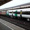 47732 delivering 377119 - Clapham Junction