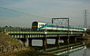 A 321 in old First Great Eastern livery on an Ipswich to Liverpool Street service, crossing the river some 6 minutes behind the Freightliner.