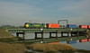 In the opposite direction the 4M87 to Crewe heads west across the river.