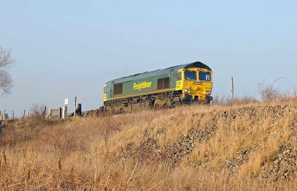 No soon had it cleared the single track than the 4L90 to Felixstowe could be heard ascending the grade to the Ouse River crossing.