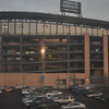 Amtrak's Wolverine train rolled past Cellular Field, home of the Chicago White Sox at sunset.