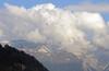 High above the Hinterrhein Valley hot air balloons rise in the still morning air.