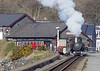 29th March. The Ffestiniog's 10:15 departure to Blaenau is prepared at Porthmadog Harbour station, 0-4-4T single Fairlie Taliesin is shunting a couple of extra carriages onto the train.
