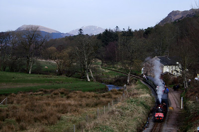 River Mite waits at Muncaster Mill while passengers board, with Scafell visible on the skyline, 10/04/10.