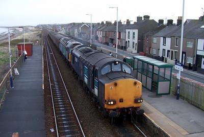 37607, piloting a failed 47501, rolls into Flimby station on the Cumbrian Coast with 2Z19 0725 Maryport - Workington, 09/03/10.