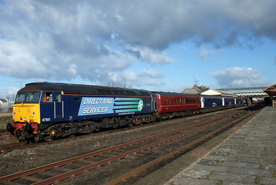 47501 Craftsman and the colourful formation of the shuttle train at Workington, 10/02/10.