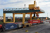 One of the gantry cranes picks up a Hyundai container for loading on the train.